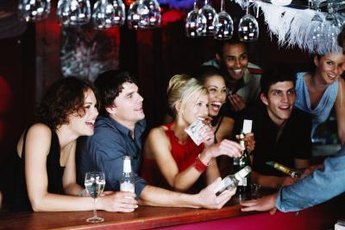 Know your employer's alcohol policy before sharing pictures of a night on-the-town.