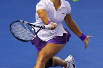 Strong calves help China's Li Na quickly move around the court.