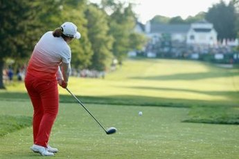 LPGA star Inbee Park rotates her torso through impact.