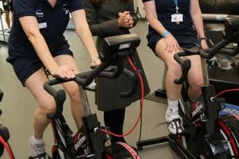 Prince William's wife Kate greets female soccer players training on spin bikes in England.