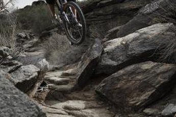 Mountain bikes vary in frame styles, materials, wheel size, clearance and other aspects.