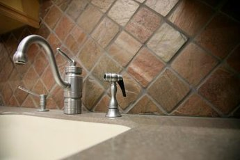 Inexpensive tiles are one idea for a frugal backsplash..