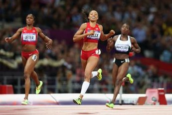 Allyson Felix crosses the finish line first for Olympic gold in the 200 meters.