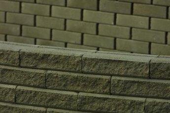 Brick masons use a variety of tools to build or repair walls.