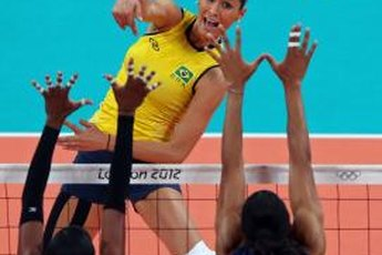 Jaqueline Carvalho of Brazil spikes the ball against the U.S. women's squad in Olympic play in London.