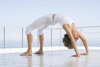 Kick over from a handstand to land in a bridge position.