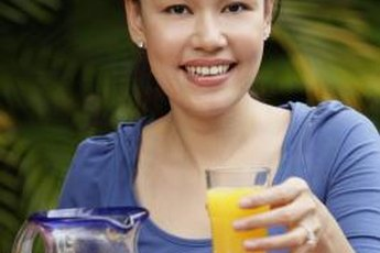 Taking vitamins with fresh orange juice is fine.