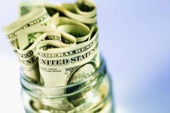 Money jars can help you track and control spending.