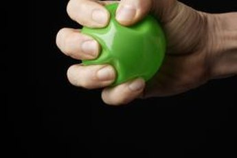 Pick a ball that fits in the palm of your hand so you can bend your fingers farther as you squeeze.