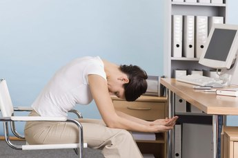 Exercises Done at Your Desk to Strengthen Your Back