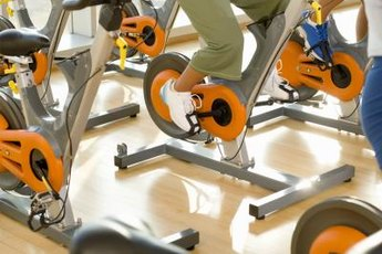 Tone your legs with indoor cycling.
