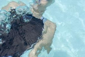 Suit up and strengthen your core in the water for a refreshing, effective workout.