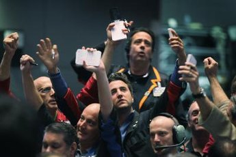 Gold futures trade both on the commodity exchange floors and electronically.