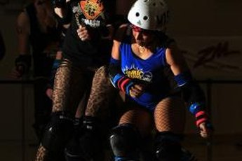 Blocking is a critical part of roller derby action.