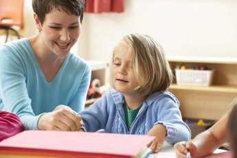 Teachers guide their pupils as they learn and develop.