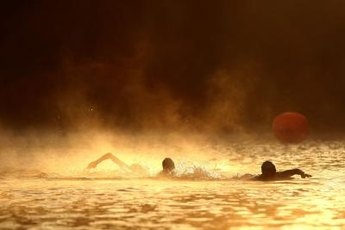 Swimmers cross the Russian River during a half Ironman in Northern California.