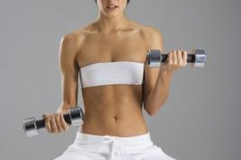 Tone and tighten with weights and a balance ball.