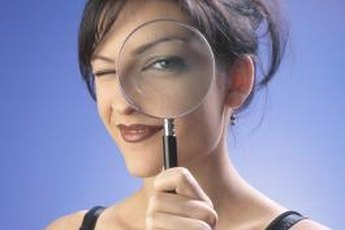 Criminal investigators spend much of their time examining crime scene photos and police reports.