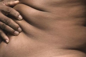 Establish a regular workout routine to keep your stomach flat.