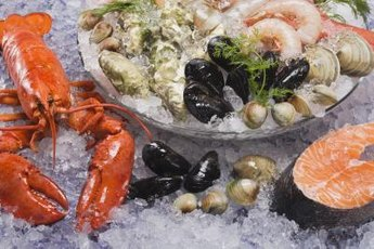 Low-cholesterol seafood includes deepwater fish and some types of shellfish.