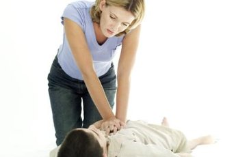 A CPR instructor teaches cardio pulmonary resuscitation.