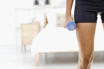 Tone your inner thighs with dumbbell exercises.