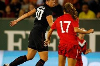 Abby Wambach heads the ball against Canada.