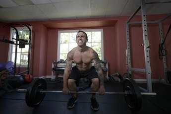 Barbell exercises are commonplace in CrossFit training.