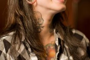 A tattooed woman wears her ink as an accessory.
