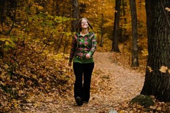 Hiking on a natural surface trail in the woods can offer a mental escape.