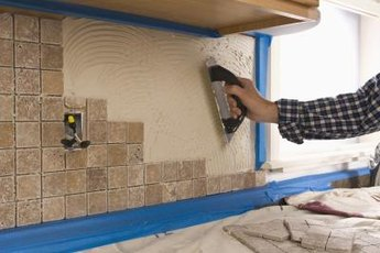 Adding a new backsplash in the kitchen might boost your home value.