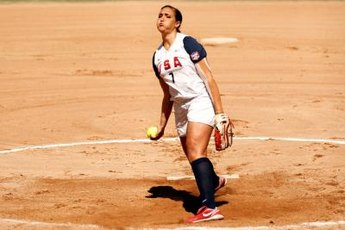 A Team USA pitcher prepares to release a pitch.
