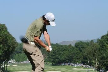 Rory McIlroy keeps his right elbow near his hip midway through the downswing.
