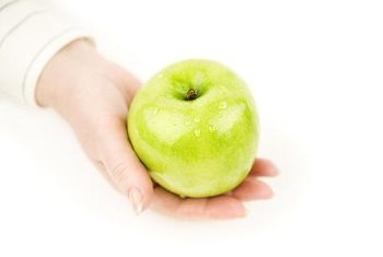 An apple is high in fiber and water, which helps reduce hunger.