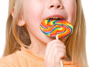 The dangers of sugar consumption in children include cavities, obesity and poor nutrition.