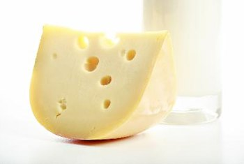 Milk and cheese are high in lactose.