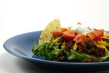 Taco salad made with ground turkey has less fat than traditional versions.