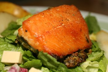 Salmon contains omega-3 fatty acids that help lower cholesterol.