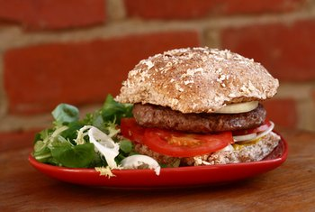 Order a hamburger with a side salad instead of french fries for a healthier meal.