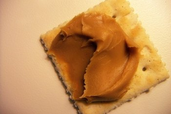 Spreading peanut butter on crackers or celery sticks is a quick way to get protein.