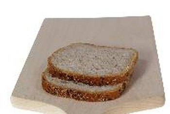 The high fiber content of whole-grain bread lowers its net carb count.
