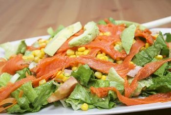 A salmon salad with nuts is high in vitamins D and E.