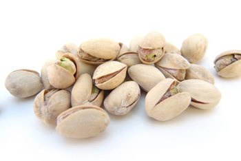 You'll eat fewer pistachios if you have to shell them first.