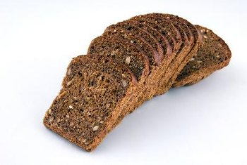 The complex carbohydrates in whole-grain bread are broken down by enzymes during digestion.