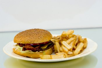 A cheeseburger and fries can contain more saturated fat than you need in an entire day.