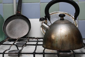 Remove dirt and grime off an enamel stove.