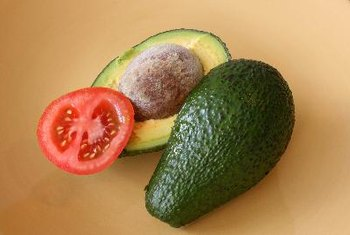 Avocados and tomatoes in guacamole offer a delicious, nutritious combination for kids.