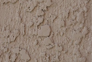 You must be slow and meticulous when attempting to remove spray paint from stucco.