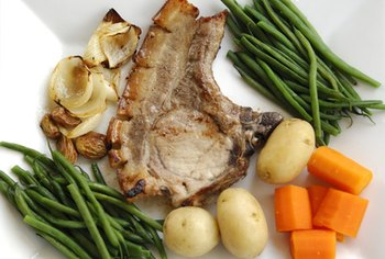 Having a pork chop for dinner provides potassium without adding carbohydrates to your diet.