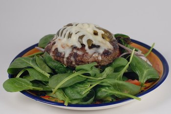 A hamburger and spinach are dietary sources of iron.